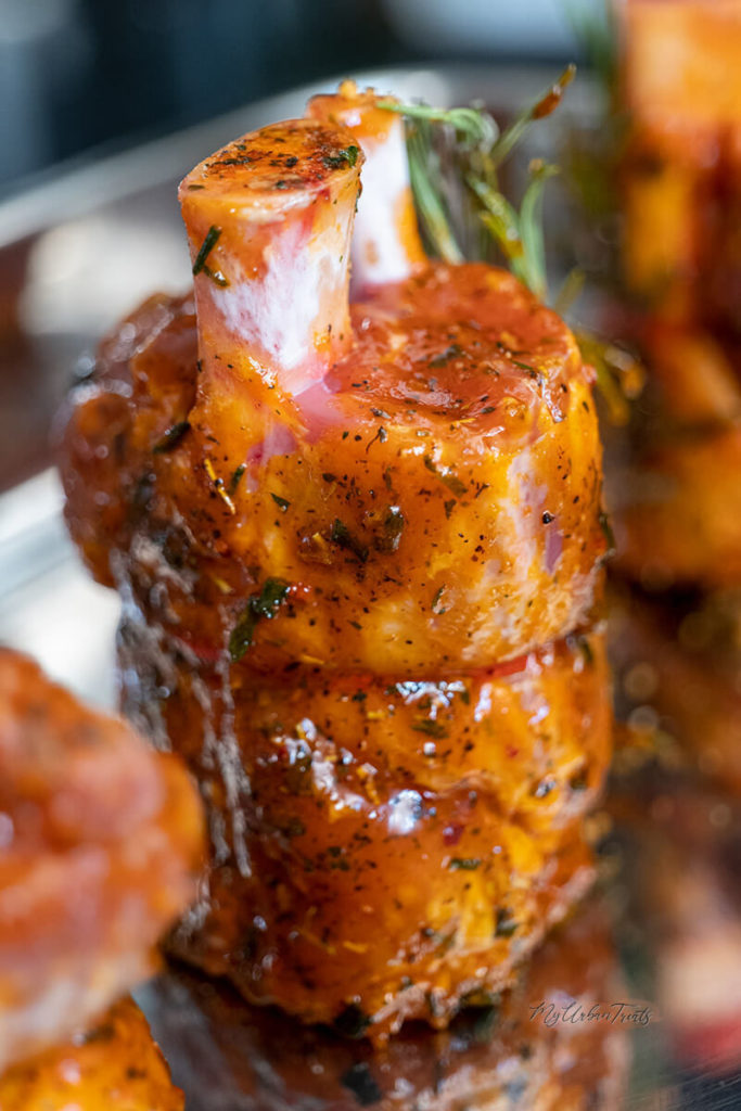 A basted and marinated pork shank in barbeque sauce and rosemary