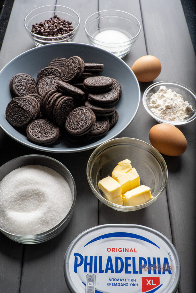 Ingredients for Oreo Chocolate Chip Cheesecake, Cream Cheese, Sugar, Butter, Flour, Chocolate Chip and two sleeves Oreo Cookies