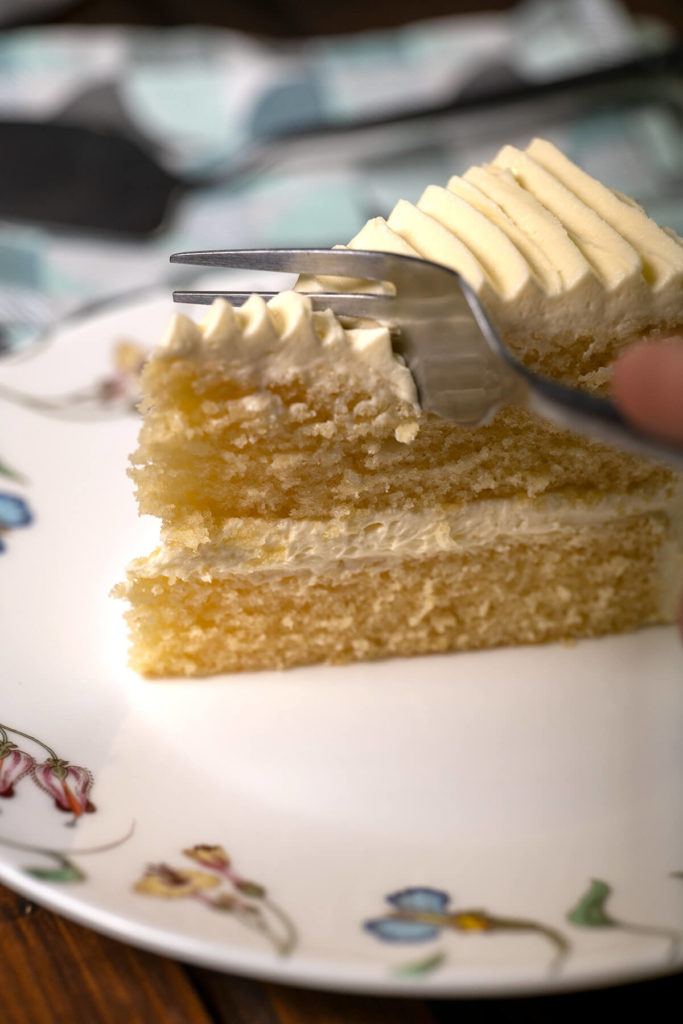 A soft and fluffy textures sponge cake layered with white vanilla buttercream.